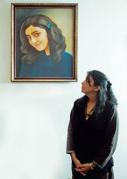 Framed? Nupur Talwar with daughter Aarushi's portrait | Photo: Garima Jain    Dead ends and bizarre twists    Four years after Aarushi's murder, the CBI has arrested Nupur Talwar as a prime suspect. Gaurav Jain poses some hard questions for the agency in this macabre narrative  http://www.tehelka.com/story_main52.asp?filename=Ne120512AARUSHI.asp  #aarushi #murder #nupur talwar #parents #CBI #suspect #twist
