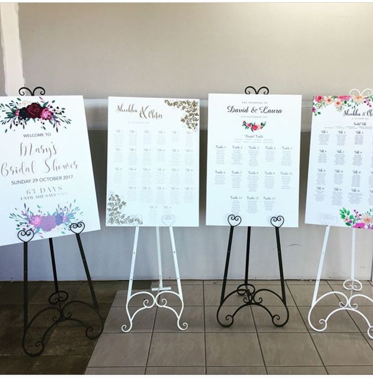 An array of custom designed guest Welcome me Boards and seating charts