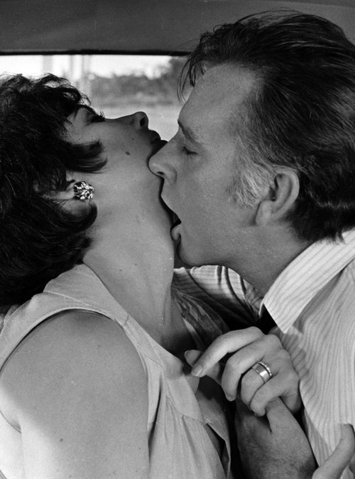 "Richard Burton nibbles on Elizabeth Taylor in ""The Comedians"", 1967. °"