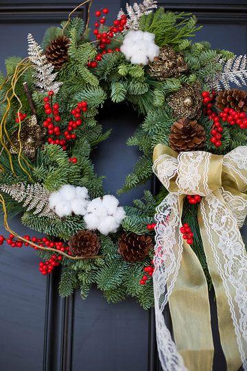 Fresh winter wreath with ilex berries, pines cones, curly willow & raw cotton.  Wreath: Flowers by Janie www.flowersbyjanie.com Photo: @EmilyExon   #winterwreath #christmaswreath #ilexberries #rawcotton #lacebow #Calgaryflorist #Calgaryweddingflorist
