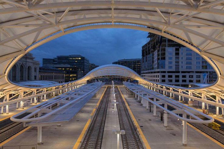 Rails terminate under a canopy of steel and Teflon-coated fiberglass at the new modern Union Station in Denver, Colorado. AECOM led the development team for a major public-private project that will result in one of the busiest, most dynamic urban centers in the world.