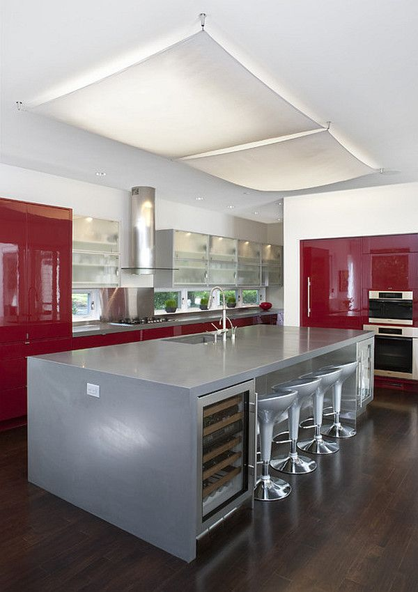 Glossy dark #red #cabinets and silver #kitchen island by Anthony Wilder #Design/Build