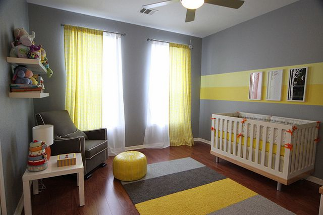 This modern baby nursery in grey and yellow is cheerful and striking. Loving this gender-neutral look.