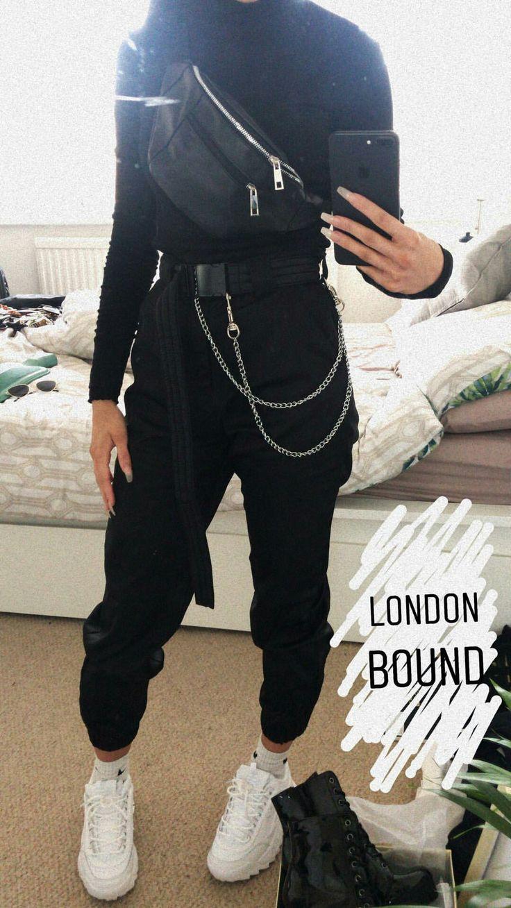 black turtleneck + black leather waist bag (worn as cross body) + black pants + white sneakers