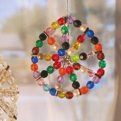 Safety Pin Sun-catcher | Craft...going to try this with Godteens for Christmas cards for the nursing home residents!
