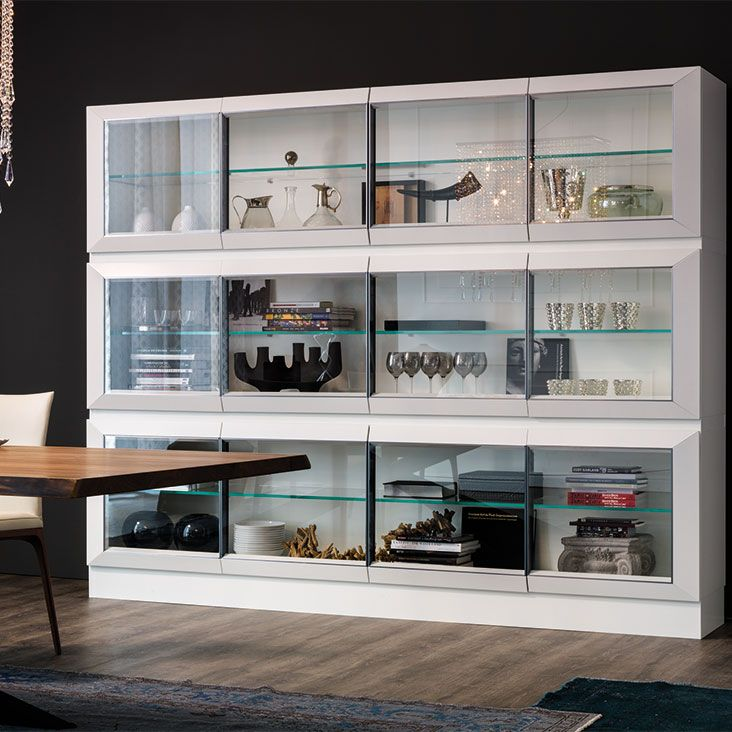 Sideboard, display cabinet in matt white (OP7) or graphite (OP69) lacquered frame. Door profiles lacquered in matt white (OP7) or graphite (OP69) or Canaletto walnut (NC). Doors and internal shelves in extra clear glass. Sideboard h74 and h139 with top in white or graphite painted extra clear glass. Optional: internal led light kit.