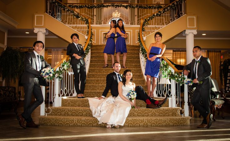 Idea for bridal party photos; could just have us all staggered down the bannisters as well