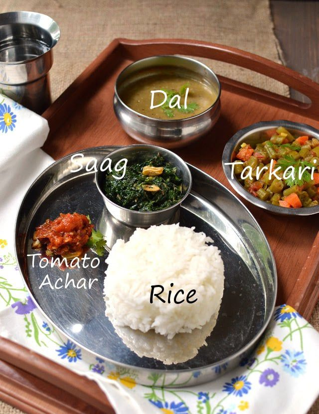 Nepali Vegetarian Thali with Dishes: Dal Bhat (Dal & Rice), Tarkari -- Mixed Vegetable Curry, Saag (Curried Spinach) and Tomato Achar (Chutney)