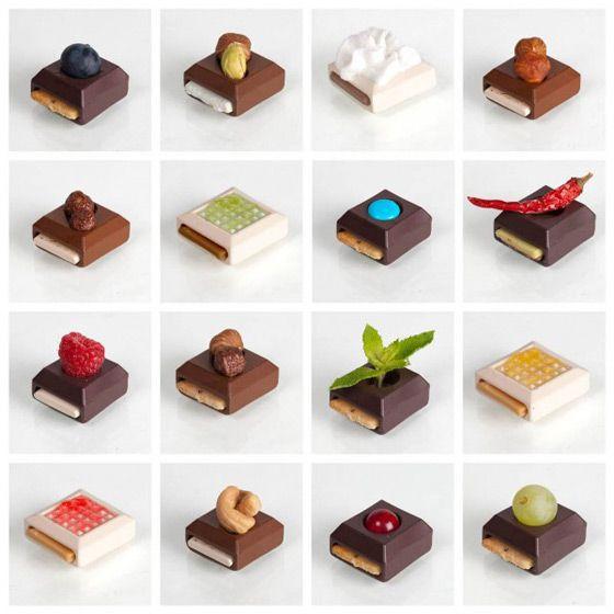 Sweet Play - Шоколадный конструктор  концепт Sweet Play — конфет, которые можно «собрать» самому, придумав начинку и украсив фруктами или орехами.За основу берутся формы-контейнеры из черного, молочного и белого шоколада, в середине которых есть полости для разной начинки типа вафель, нуги или карамели, а наверх можно положить орехи, фрукты или добавить варенье (мед, сироп).