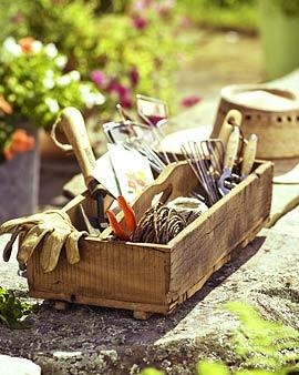 good tools are essential for good gardening .. love the folk art wooden carry-all