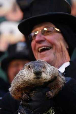 Groundhog handler Ron Ploucha reacts after hearing the famed weather prognosticating groundhog Punxsutawney Phil's annual prediction in Punxsutawney, Pa.