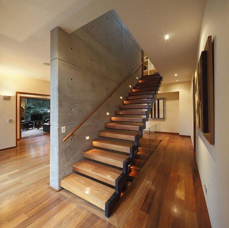escalier droit et suspendu à limon latéral, avec main-courante en bois