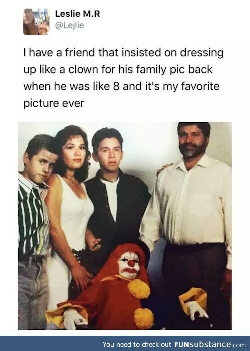 What the hell? How can a kid look that scary? And a family photo where no one is smiling? It's all mixed up.