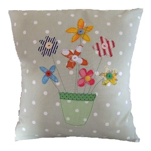 A burst of colours from the pretty Spring flowers can cheer anyone's mood. These bright flowers have been appliqued onto the handmade cushion using recycled fabric and vintage buttons to add that extra special touch.