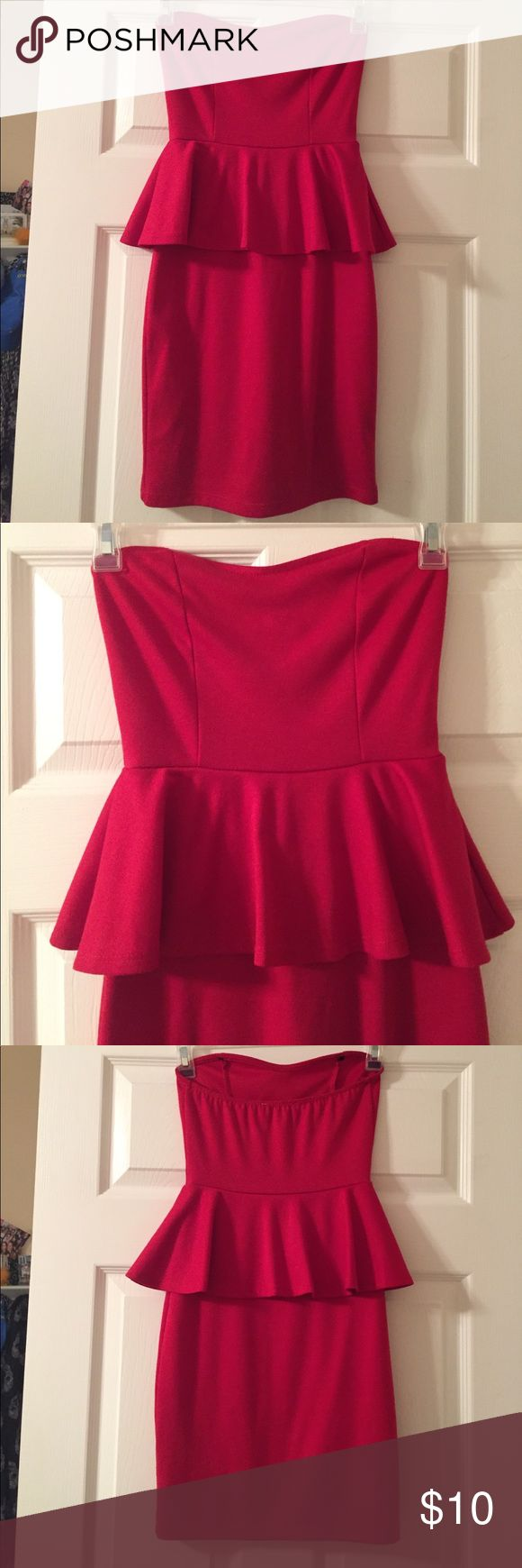 Red Strapless Peplum Dress Strapless red peplum dress in a nice stretchy material. Looks great for a formal or nicer occasion! Neckline is a slight sweetheart style. Only worn once. delias Dresses Strapless
