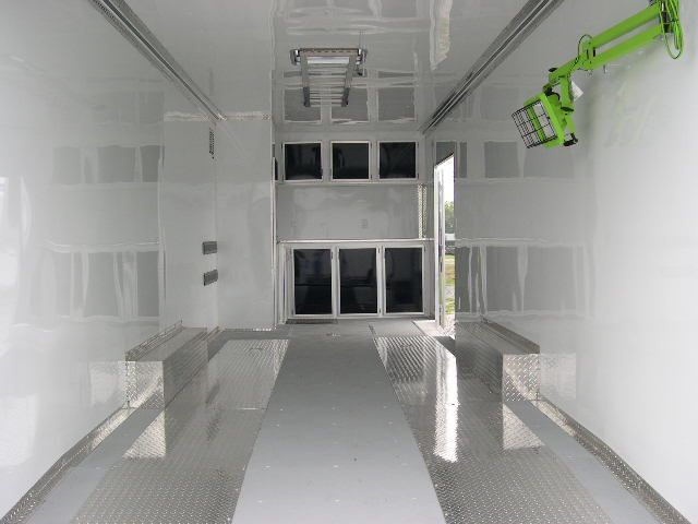 All-white custom trailer interior.  We customize trailers right to our customers specifications with trailer accessories, cabinets, flooring, and more. If you want it, we can add it.