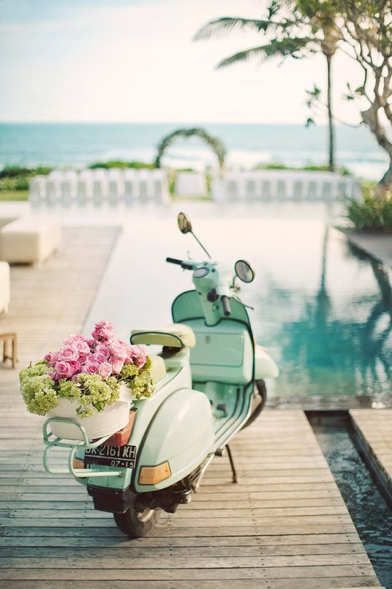 a gorgeous vespa full of pink roses, love the beautiful outlook of pool & sea |  photos by erika gerdemark | style me pretty