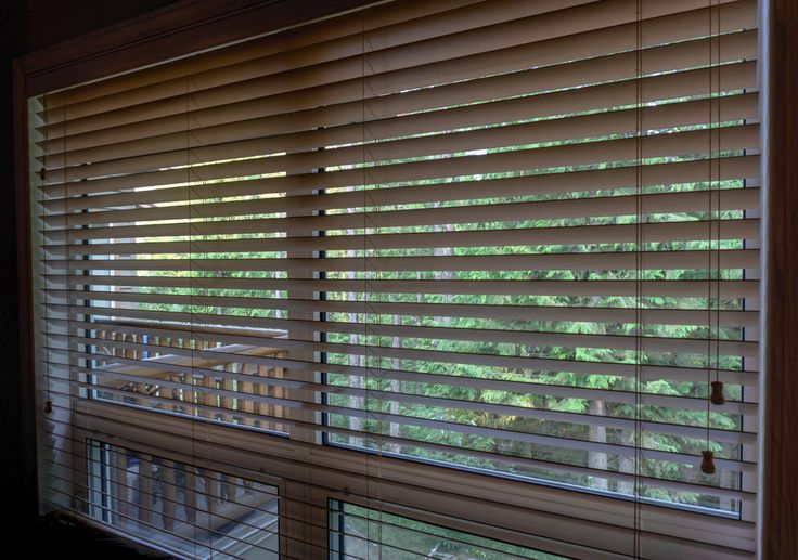 Wooden Blinds I Finished in white allows them to compliment a space with many natural wood elements. Contact us to set up your consultation.