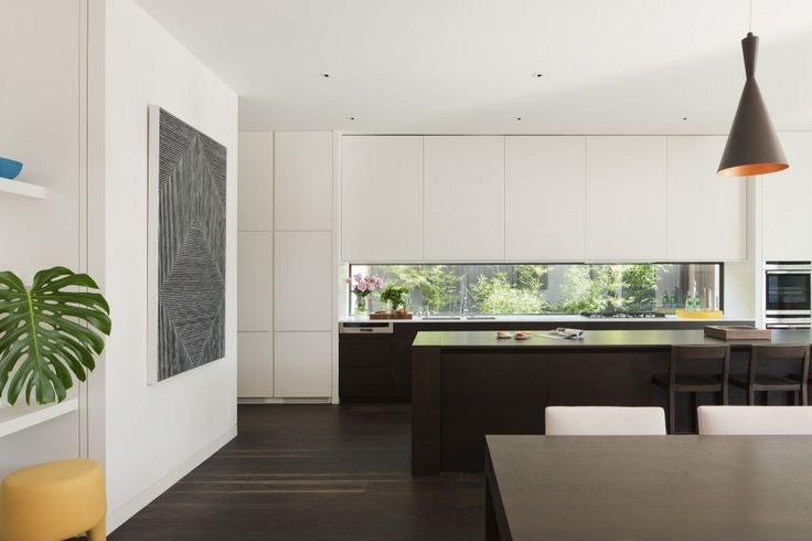 Loving how this kitchen flows into the butlers pantry and also the dining area. Love the integrated fridge but costs a bomb. Loving the idea of a huge art work. On the wall   Malvern House / Canny Design