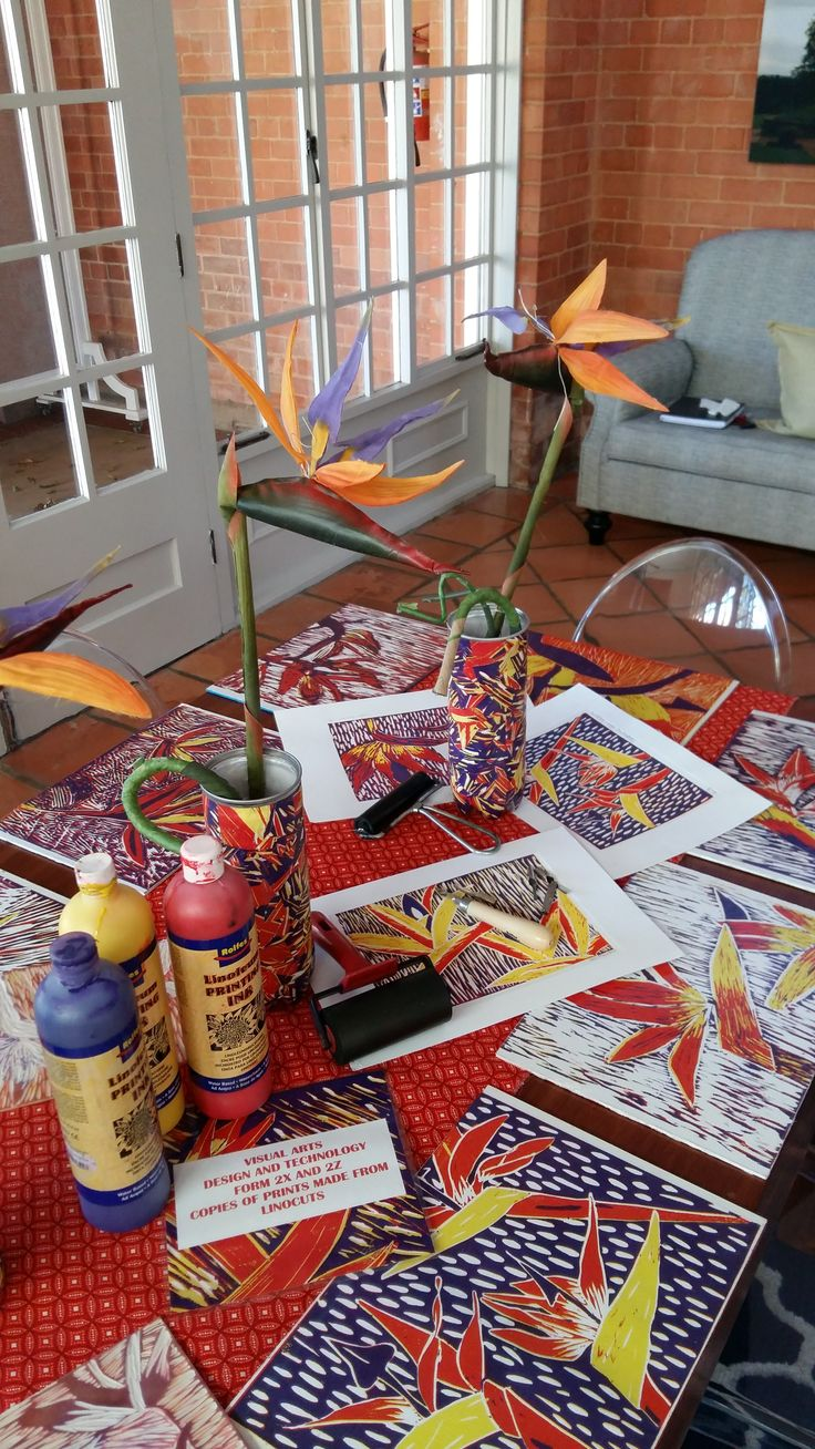 Table display showing, linoprints made in Art, place mats made from copies in Design & Technology.