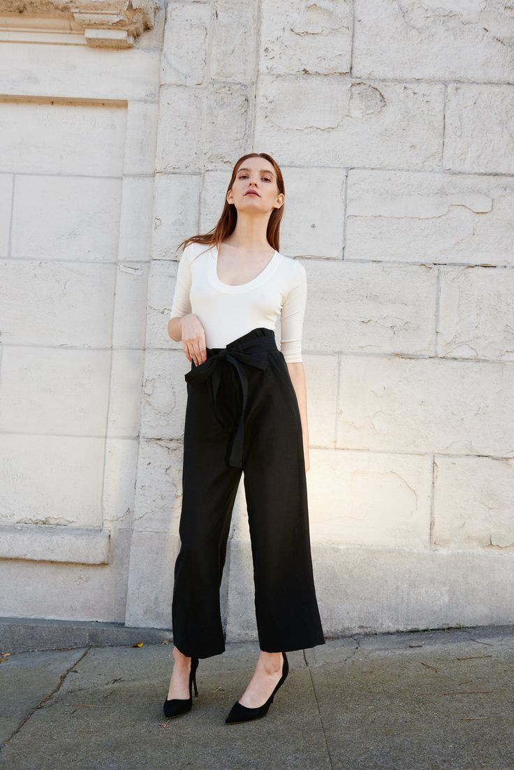 Le Tour Paperbag Pant in Black    Paperbag pants constructed from a mid-weight silk linen fabric. Cropped   length with button fly closure and self belt.Features side pockets and   wide hem. 70% Silk, 30% linen.Made in California.