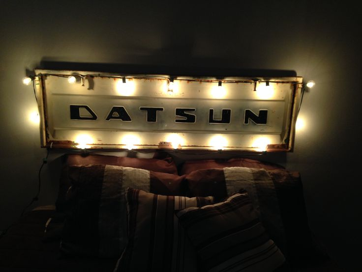 Truck tailgate used for a headboard.
