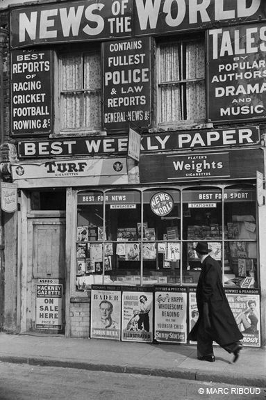 News of the world, the weekly tabloid that is no more... London, 1954. Marc Riboud.