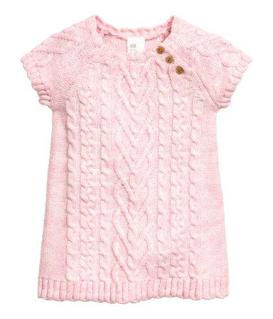 Light pink melange. Dress in soft cable-knit fabric with wool content. Short sleeves and buttons at top.