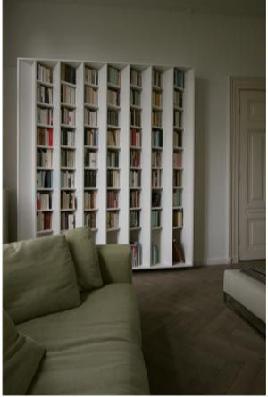 Angled bookshelf.  You see the books from one side but not the other.