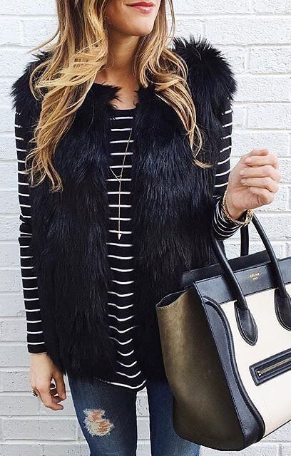 #winter #fashion /  Striped Top / Black Faux Fur Vest / Celine Leather Tote Bag / Ripped Skinny Jeans