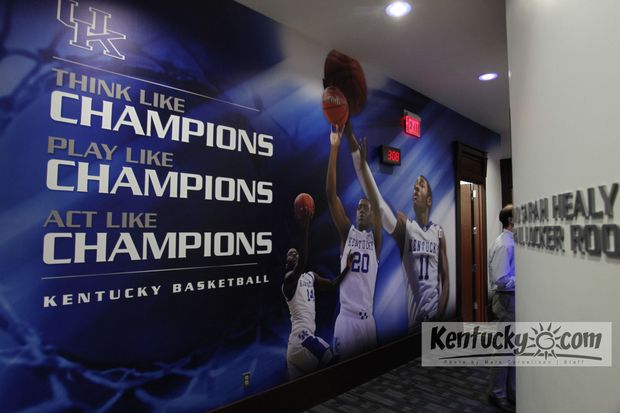 A motivational illustration covers a wall in a hallway of the new UK men's locker room at Rupp Arena.