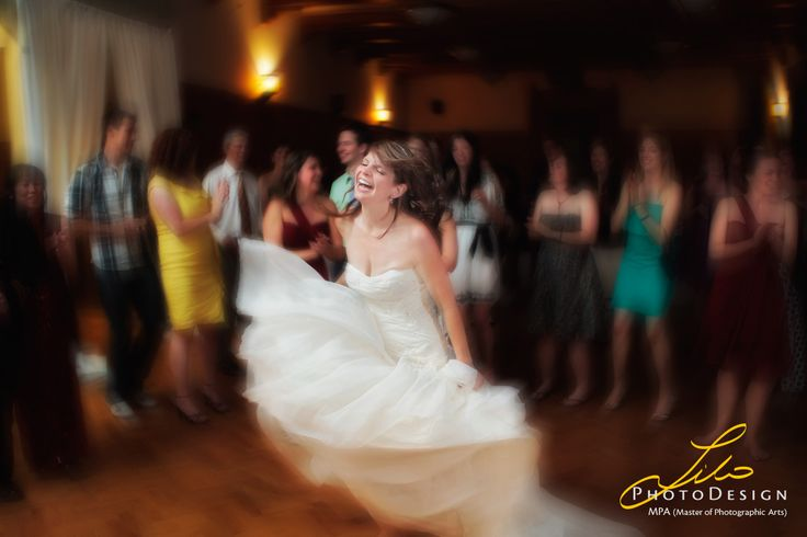 Here an example of a bride having a terrific time. Image captured by lilophotodesign.ca