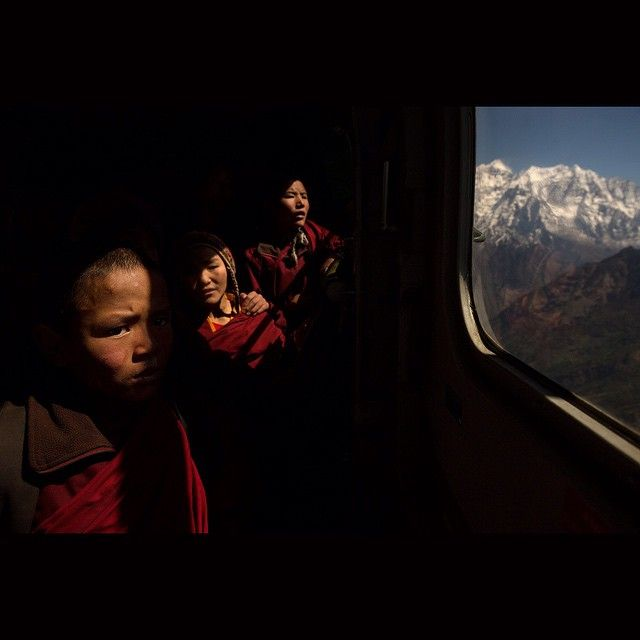 This is yet another photo taken by James Nachtwey.  Here the Buddhist monk were rescued by helicopter who were affected by recent earthquake of Nepal. And in the right is Himalayas of which Nepal is famous for .