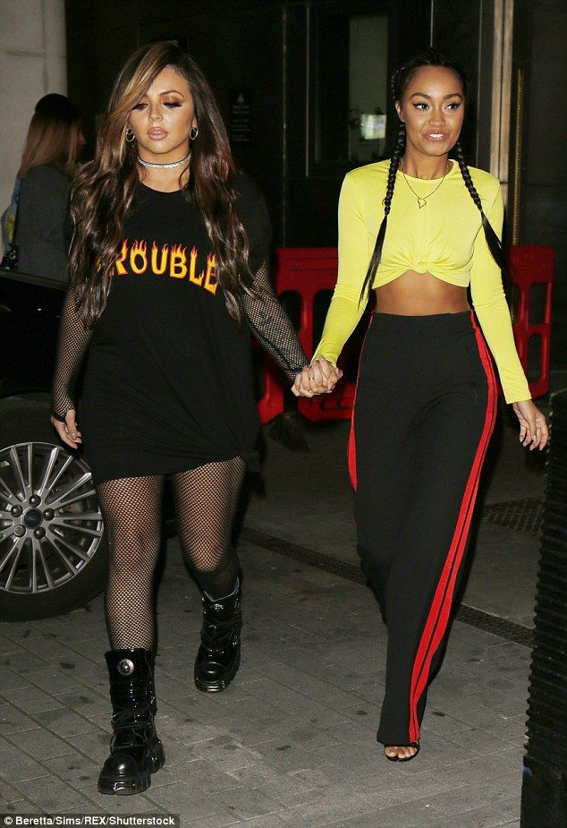 Here come the girls: Leigh-Anne Pinnock and Jesy Nelson followed suit, holding hands as th...