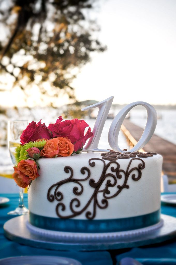 10th anniversary cake with scroll design teal ribbon and flowers anniversary cakesanniversary ideaswedding