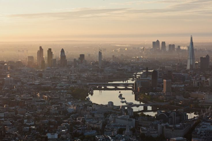 An aerial view of London at sunrise, in June 2012, looking east towards the City with Canary Wharf in the distance. Photograph: High Level Photography/Rex Fea
