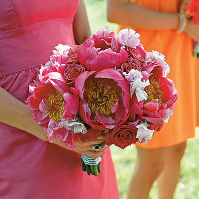 This bridesmaid's bouquet features hot pink giant peonies and pink and red roses.  Photo: Liz Banfield