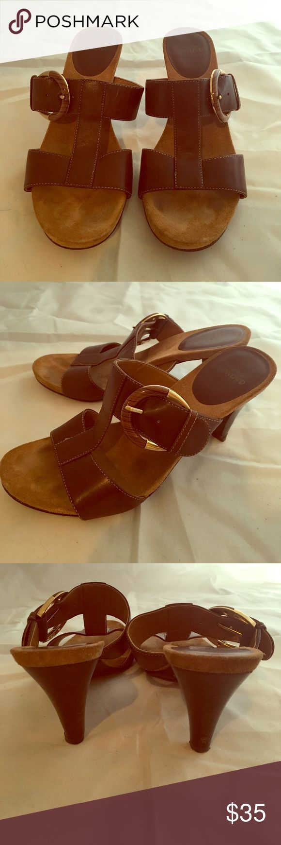 JOAN & DAVID HEELED SANDALS SIZE 7 1/2 Joan and David designer brown leather sandals. Open backs and T straps x two and ornamental Buckle  Size 7 1/2. Looks never to have been worn. Top grain leather.  3 inch heels Joan & David Shoes Sandals