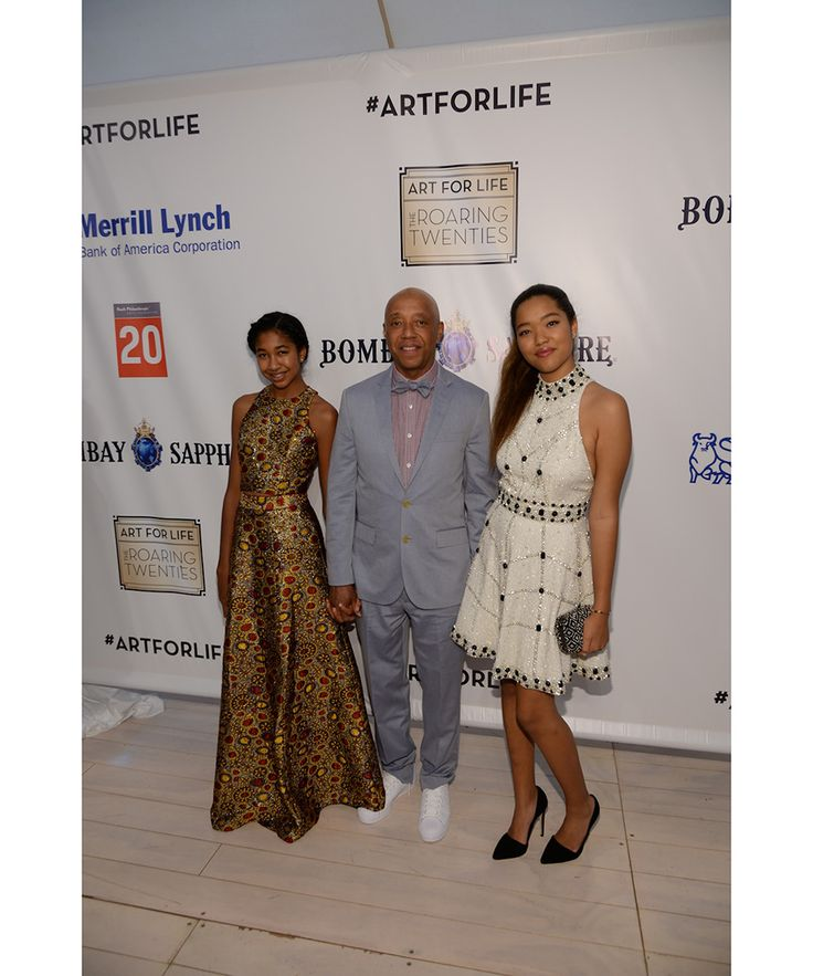 The Roaring Twenties-themed event—hosted by Rush Philanthropic Arts Foundation's founders Russell Simmons, Danny Simmons and Joseph Simmons—raised funds to support arts programming for inner city youth. Pictured above, Aoki Lee Simmons, Russell Simmons, Ming Lee Simmons.