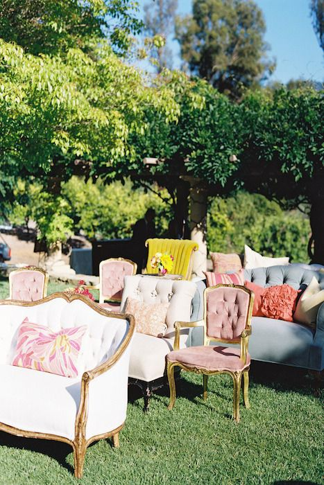 Stylish mismatched furniture is great for backyard/outdoor weddings.