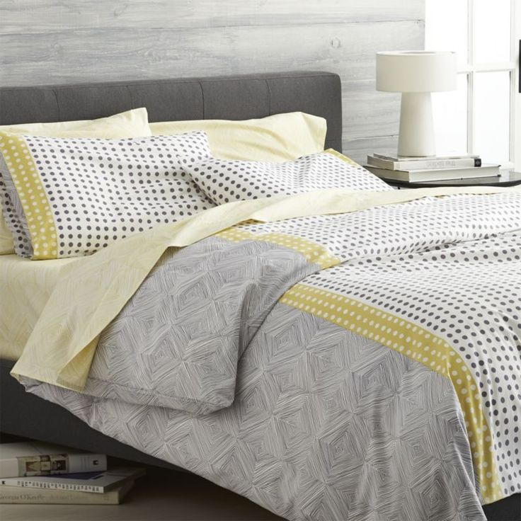 Loving the immediacy and irregularity of hand-drawn designs, Genevieve Bennett has created a stunning motif of fine lines and playful dots just for us in a fresh palette of grey and yellow on white cotton.  Reversible duvet has hidden-button closure and interior fabric ties to stabilize duvet insert; pillow shams have an inner flap closure.  Duvet inserts and bed pillows also available.