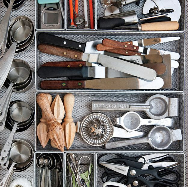 Divide up your drawers with mesh organizers from the office supply store to make sure every utensil has a spot. | 42 Brilliant Ideas To Make Your Home Really Freaking Organized