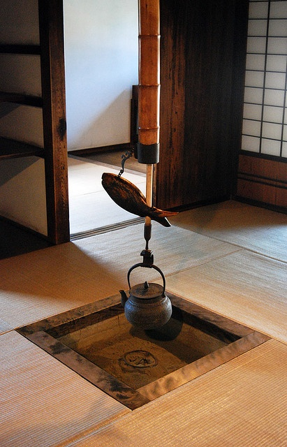 Vintage Japanese Kettle    This beautiful kettle hangs in the centre of the room, where a fire once heated it. What you don't get from the photo is the delicious smell of tatami mats, the smell of straw that inhabits every traditional japanese room.