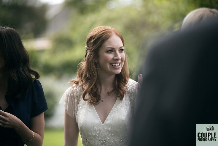 The bride chatting with guests. Weddings at Conyngham Arms Hotel, Slane, by Couple Photography.