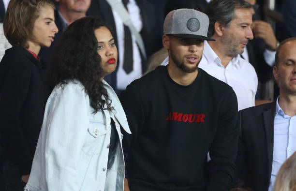 NBA champion Stephen Curry of Golden State Warriors and his wife Ayesha Curry attend the French Ligue 1 match between Paris Saint Germain and AS...