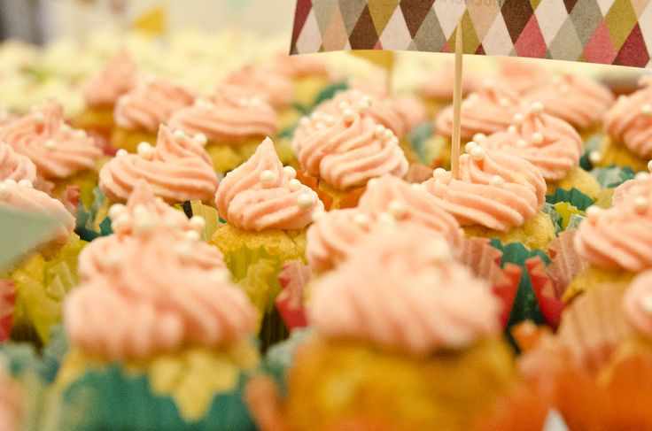 Miniature cupcakes. Cardamon with pink vanilla frosting.