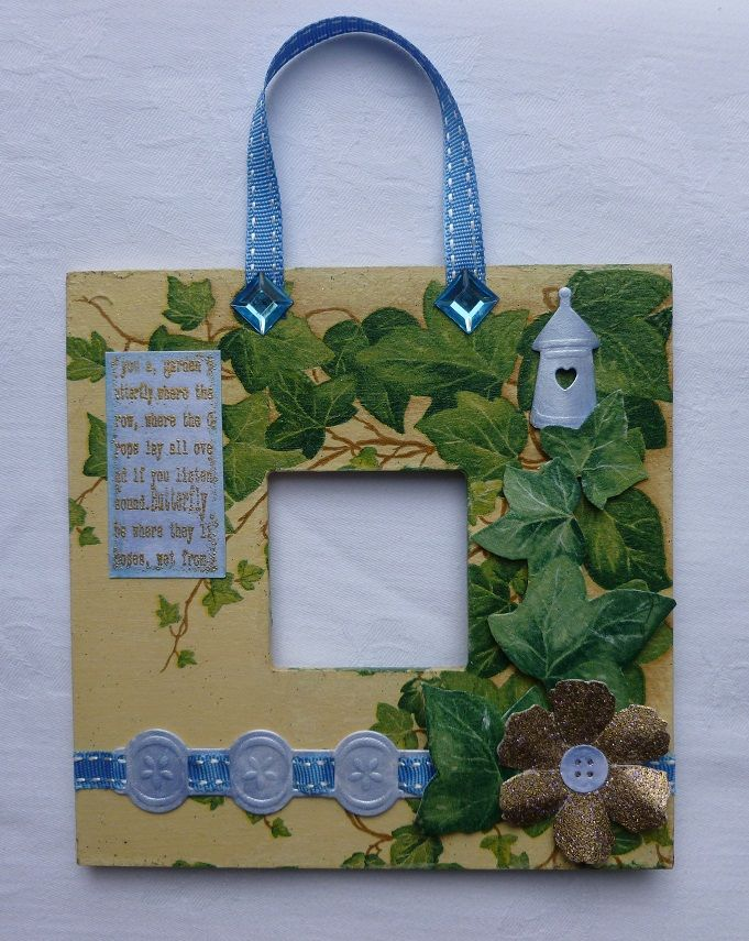 This is the reverse side of my  'Butterfly' wall plaque. - Imagination Craft's -'Butterfly'embossing stamp set. Blue mica powder. Limestone MDF paint. Ivy paper napkin.  Marianne die - Border and Birdhouse dies.