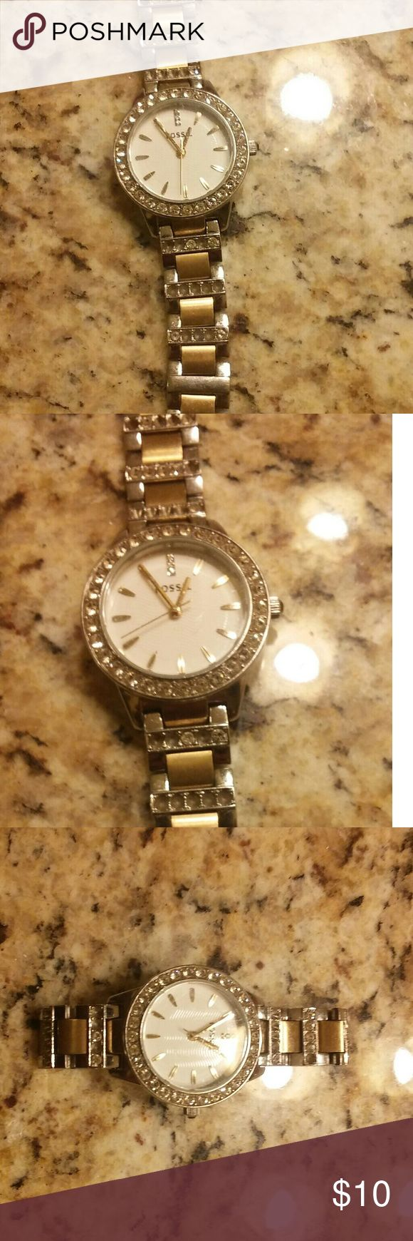 Nice Fossil watch This watch is beautiful even with bling missing...it has a new battery..6.5 inch wrist...there are stones missing but i believe Fossil will replace them cheap... Fossil Accessories Watches