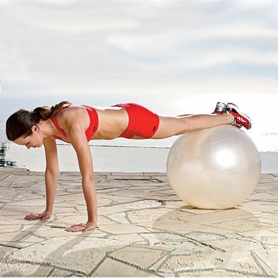 Strengthen your core even more by combining planks with an exercise ball