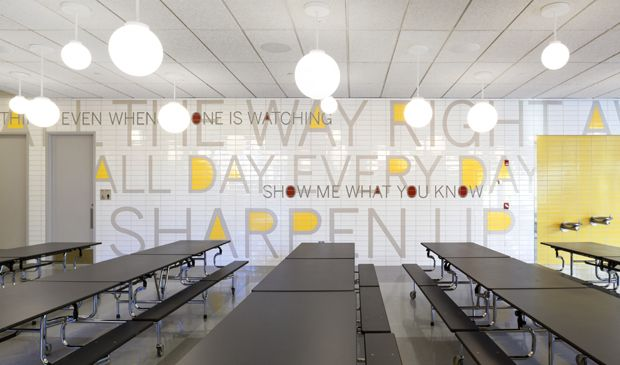 Paula Scher's supergraphics for the PAVE Academy Charter School in Brooklyn include a typographic tile mosaic in the school cafeteria.